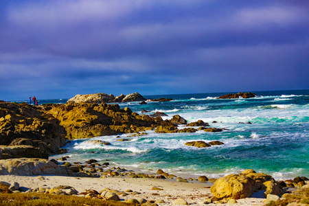 Wave action on the rocks at Pebble Beach highlighting Bird Rock, Seal Rock, Cypress Pint Golf Course, Fan Shell Beach located on the 17 Mile Drive, Pebble Beach, California