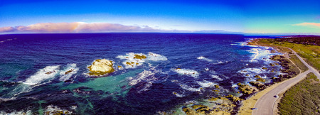Pebble Beach, California, February 17, 2018: Majestic aerial views at Pebble Beach higlighting Bird Rock, Seal Rock, Fan Shell Beach, Cypress Point Golf Course and the Monterey Penninsula Country Club.