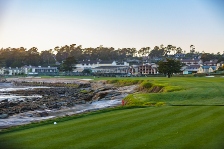 Pebble Beach, California, February 17, 2018:  The famous 18th hole at the Pebble Beach golf links offers assorted seaview vistas in addition to challenging golf shots.
