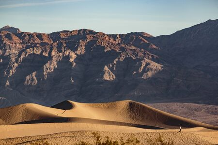Death Valley, California, USA - December 18, 2018:  Beautiful panoramas and brilliiant lighting changes create neverending vistas at the sand dunes near Stovepipe Wells Village in Death Valley National Park.