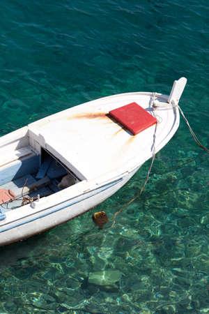 Boat floating in the harbor in Hvar, Croatia photo