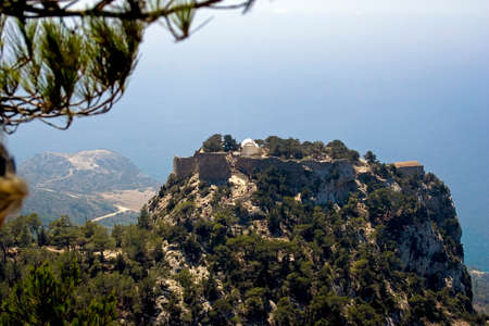 Monolithos hill with church