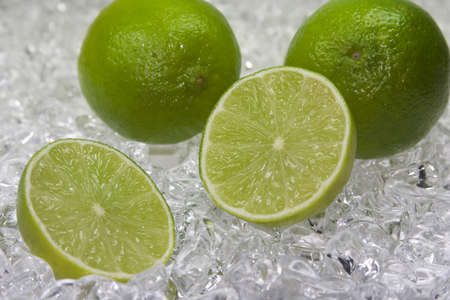 halved  half: cold fresh limette with ice in the back