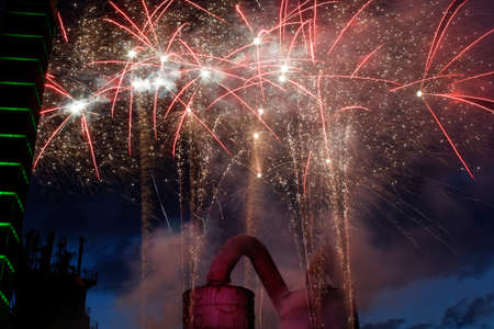 fireworks behind a  blast furnace and steel mill