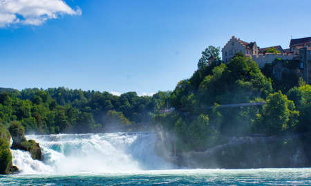 the famous rhine falls in the swiss near the city of Schaffhausen - sunny day and blue sky