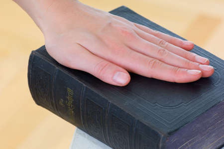Details and close-up hand on the Bible photo