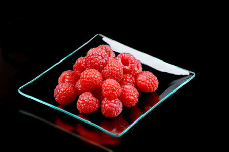 Still life and close-up of fresh raspberries photo
