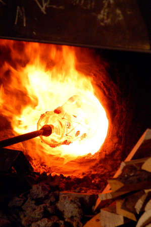 glassware in a hot flame at the workshop photo