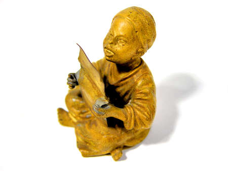 a bronze statue � little boy is singing and praying Stock Photo - 6394084