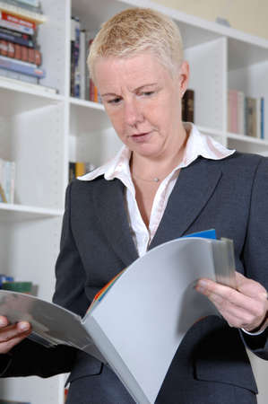 a portrait of a business woman in her office Stock Photo - 6469452