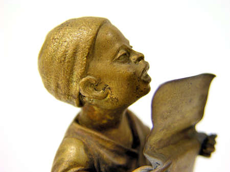 a bronze statue little boy is singing and praying Stock Photo - 6483437
