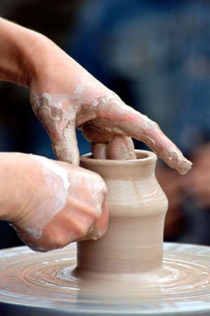 a potter on the potters wheel is mould a mut photo