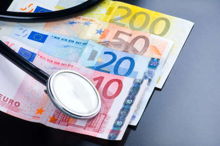 the Medicine and costs, stethoscope and money photo