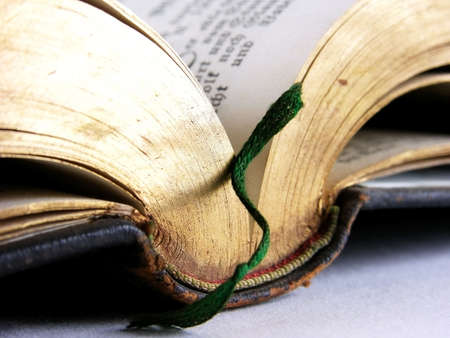 Still life and close-ups of old books, the Bible and hymnals photo