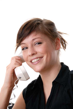 a young girl is talking to someone on the phone and make a conversation photo