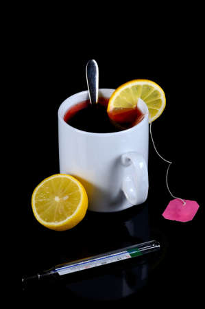 Drinks, tea, details and close-up of tea with lemon photo