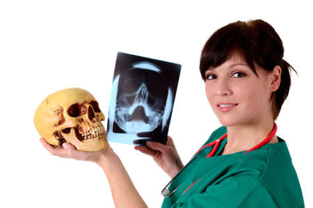Physician, pathologist holds a skull in his hand photo