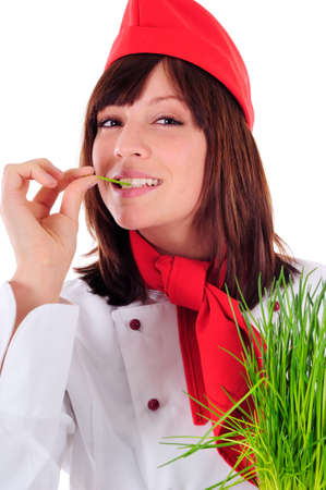 Portrait of a cook - Young beautiful women cooking photo