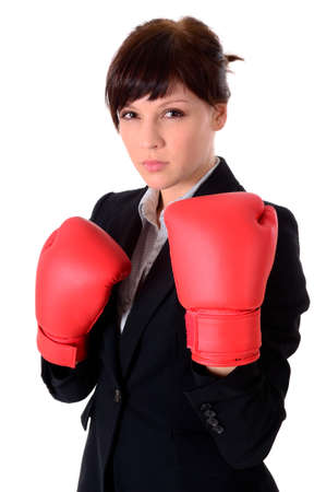 young attractive business woman with boxing gloves are ready for battle photo