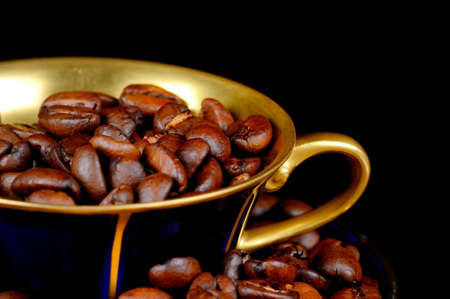 Still life of coffee, coffee cup with coffee beans photo