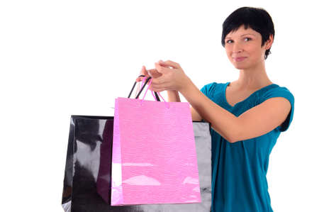 attractive young woman with shopping bags photo