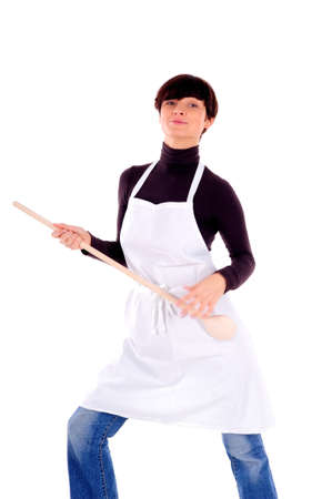 A portrait of a housewife in apron with wooden spoon photo