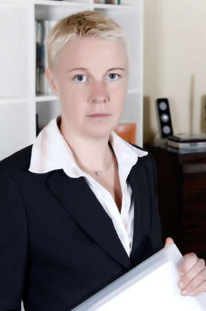 a portrait of a business woman in her office photo