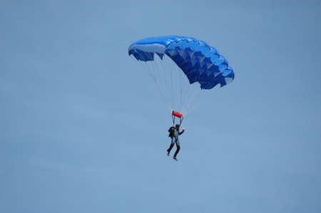 Parachute jumping, a parachutist to glide in the air Stock Photo
