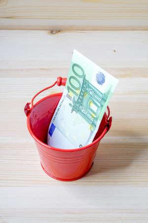 Moneybox, Euro bill in bucket Stock Photo