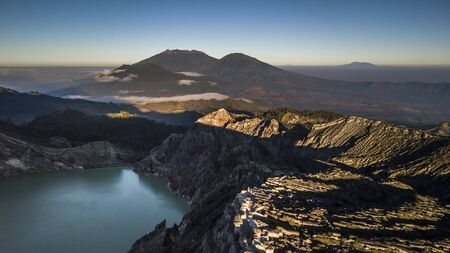 Volcano crater in Jawa with other volcano on horizon Stock Photo