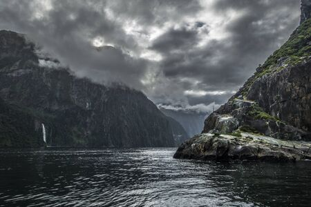 Dramatic fiord panorama with cloudy sky during rainy day Stok Fotoğraf