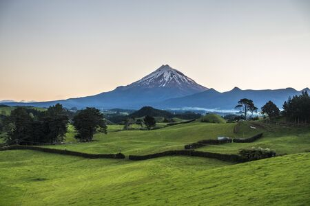 Green fields with mountain on horizon aerial view