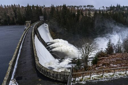 Concrete dam releasing a huge amount of water during rainy days