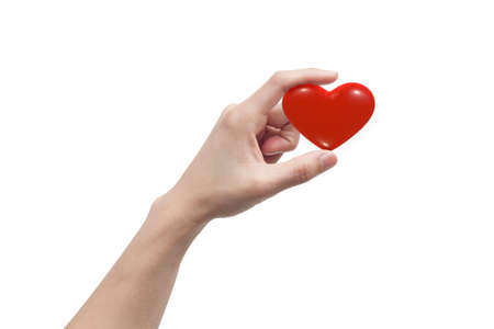 Finger holding a small heart showing love Giving to your loved ones On a isolate white background