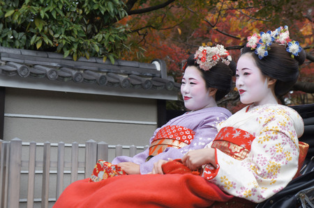 dressed up: Kyoto, Japan - November 19,2014 : Women are get Kimono dressed up as a Maiko or Geisha in Kyoto, Japan.