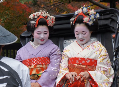 get dressed: Kyoto, Japan - November 19,2014 : Women are get Kimono dressed up as a Maiko or Geisha in Kyoto, Japan.