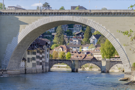 Scenic of Bridge and residental building in The city of Bern, the capital of Switzerland. Bern is built on very uneven ground. The Aare river flows in a wide loop around the Old City of Bern.