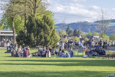 Bern, Switzerland - April 14,2017 : People relaxing at Rosengarten, The rose garden is a park northeast of the old town of Bern . It is popular as a vantage point with good views of the old town.