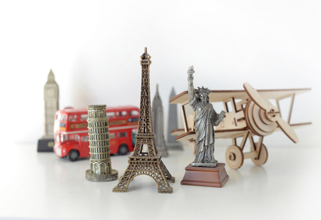 Travel and tourism concept with souvenirs from around the world. Planning summer vacation. Trip concept