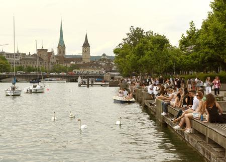 Zurich, Switzerland - June 03, 2017: People on Zurich Lake promenade. Daily life in Zurich. Editorial