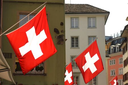 Swiss Flags on the facade building in Zurich, Switzerland Stock Photo
