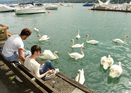 bellevue: Zurich, Switzerland - June 03, 2017: People on quay Lake Zurich. Daily life in Zurich.