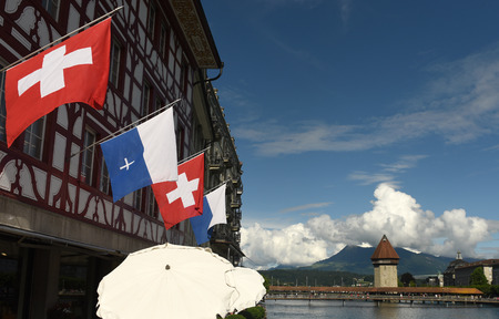Swiss Flag and Flag of Lucerne on the facade building in Lucerne, Switzerland Stock Photo