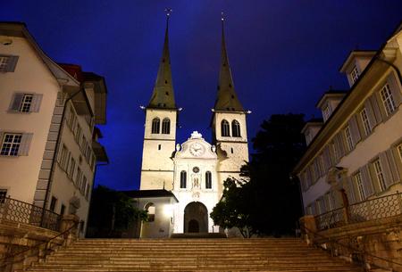 st: Church of St. Leodegar at night in Lucerne, Switzerland