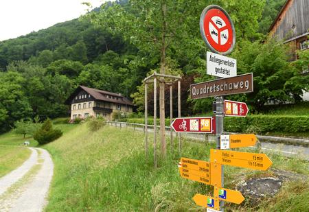Vaduz, Liechtenstein - June 02, 2017: Signs on the road near Gutenberg Castle in Vaduz, Liechtenstein.