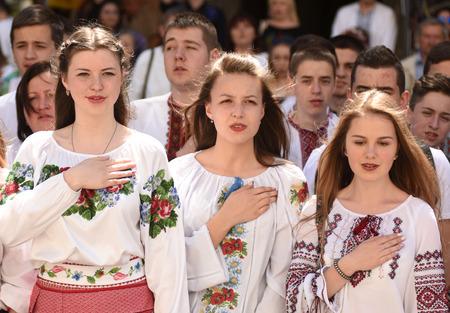 LVIV, UKRAINE - MAY 18, 2017: People wearing Vyshyvanka,(traditional Ukrainian embroidered blouses), sing the National anthem during world celebration Vyshyvanka Day in Lviv, Ukraine.