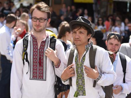 LVIV, UKRAINE - MAY 18, 2017: People wearing Vyshyvanka, (traditional Ukrainian embroidered blouses), sing the National anthem during the world celebration Vyshyvanka Day in Lviv, Ukraine.