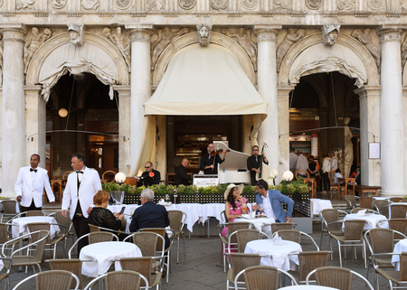 Venice, Italy - June 07, 2017: People in cafe on San Marco square in Venice.