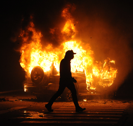 Burning car, unrest, anti-government, crime Stock Photo