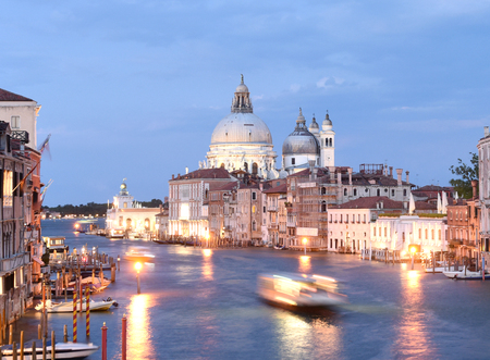 Venice cityscape at night with Grand Canal and Basilica Santa Maria della Salute, Italy. Stock Photo